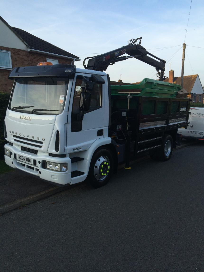 Grab lorry loaded with skips