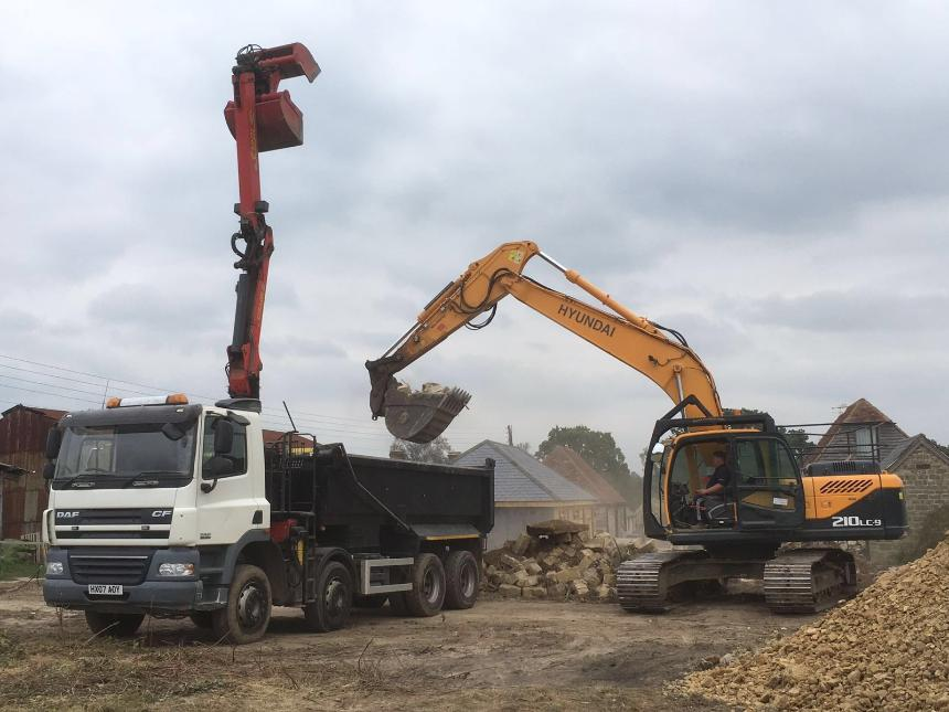 Digger loading 8 wheel grab lorry